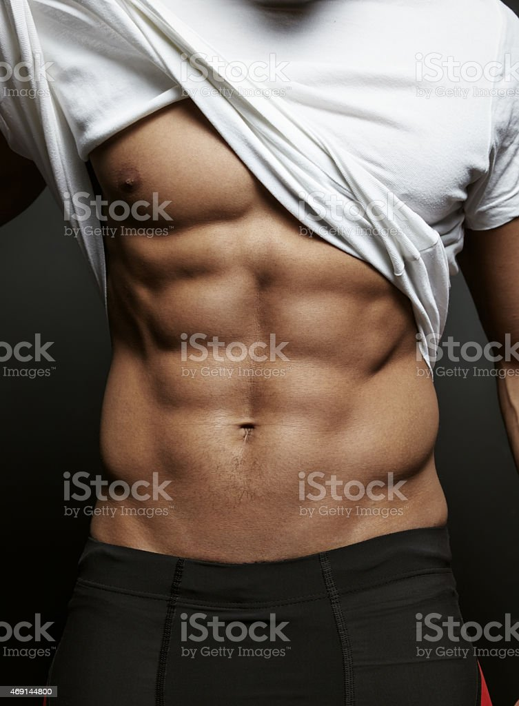 Closeup photo of an athletic guy with perfect abs stock photo