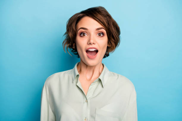 Closeup photo of attractive business lady short bob hairstyle good mood open mouth listen boss promoted her wear casual green shirt isolated blue color background stock photo