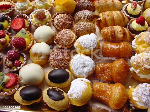 close-up of fresh italian pastries with cream and fruit
