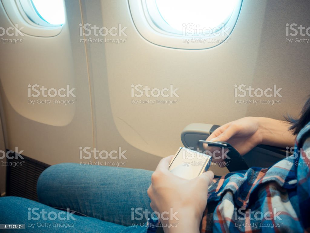 closeup photo of female traveler taking the plane stock photo