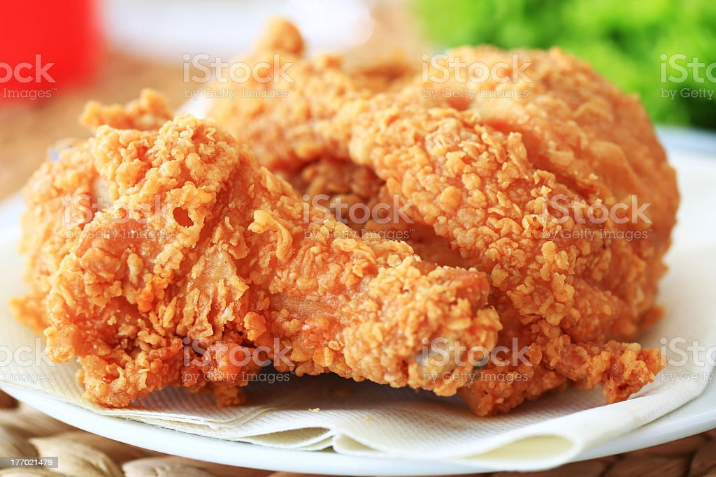Close-up photo of fried chicken on white plate stock photo
