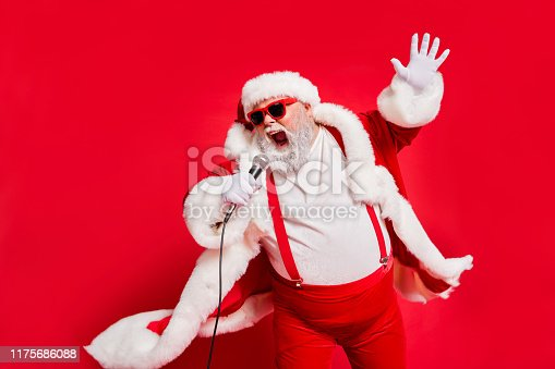 Closeup photo of funny funky wild vocalist screaming in microphone, wearing fur coat gloves suspenders isolated bright background