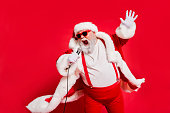 istock Closeup photo of funny funky wild vocalist screaming in microphone wearing fur coat gloves suspenders isolated bright background 1175686088