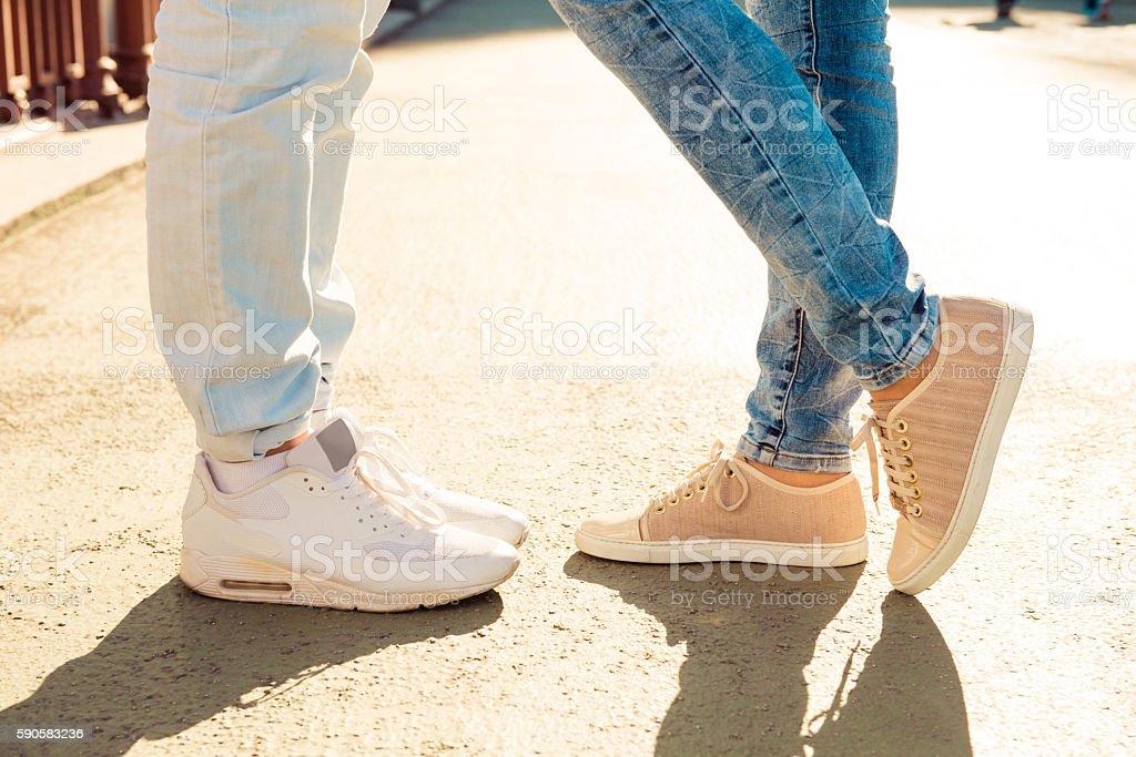 Closeup photo of legs of nice couple in love stock photo