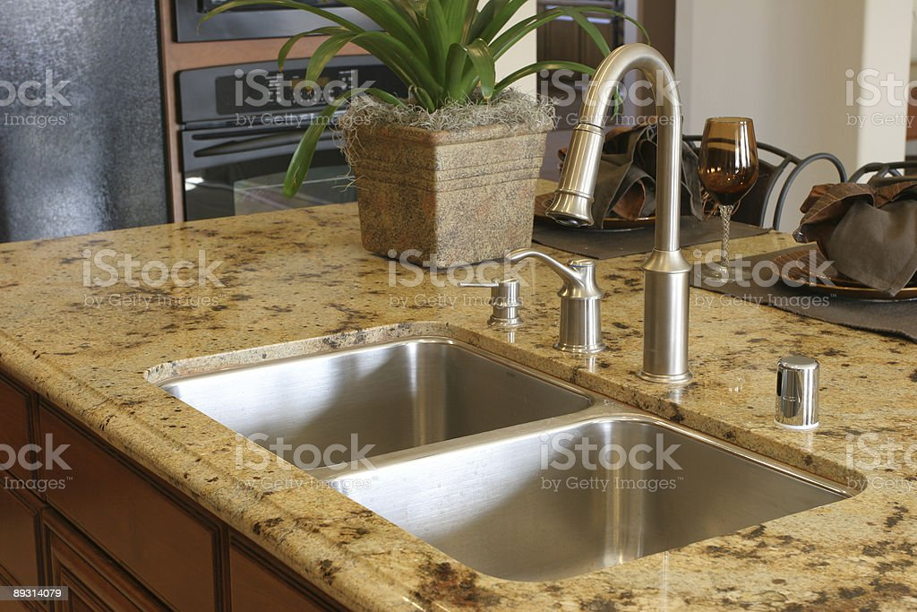 Close-up photo of modern stainless sink from kitchen series royalty-free stock photo