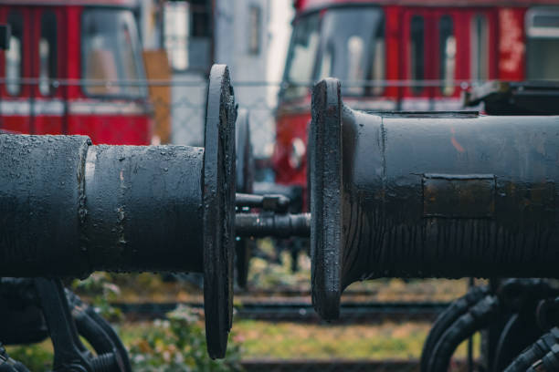 Close-up photo of oiled buffer coupling of old train locomotives on a rainy day Close-up photo of oiled buffer coupling of old train locomotives on a rainy day. coupling device stock pictures, royalty-free photos & images