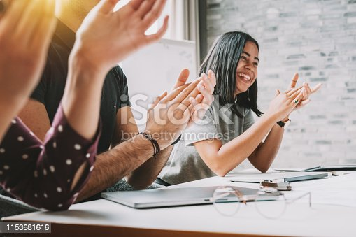 istock closeup photo of partners clapping hands after business seminar 1153681616