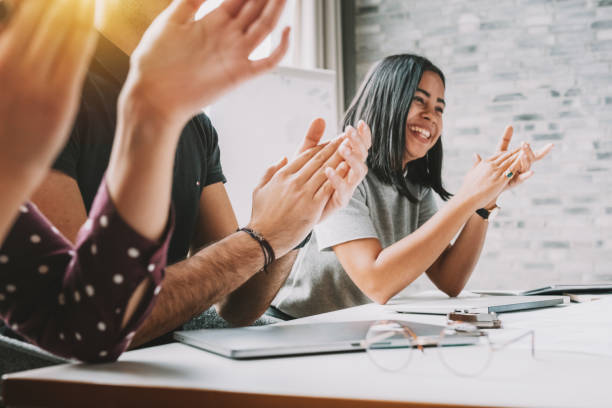 closeup photo of partners clapping hands after business seminar closeup photo of partners clapping hands after business seminar achievement stock pictures, royalty-free photos & images