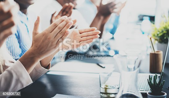 istock Closeup photo of partners clapping hands after business seminar. Professional 626305732