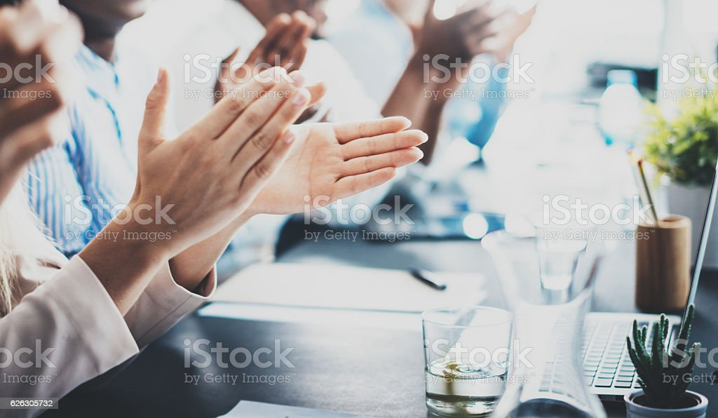 Closeup photo of partners clapping hands after business seminar. Professional - foto de stock