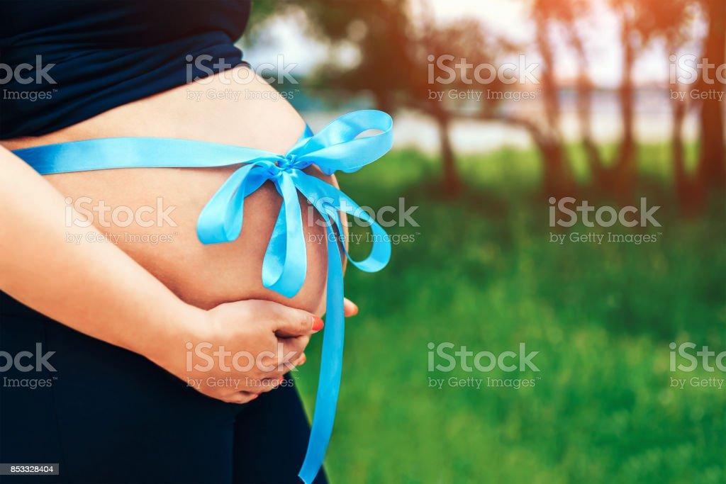 Closeup photo of pregnant woman stock photo
