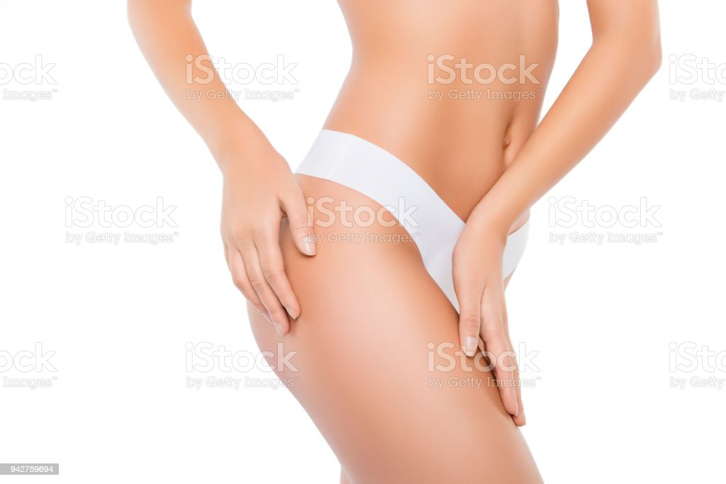 Closeup photo of slim woman with perfect body in underwear touching hips stock photo
