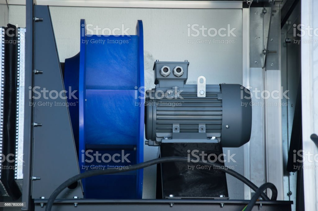 Close-up photo of the electric fan motor placed in the air handling unit stock photo