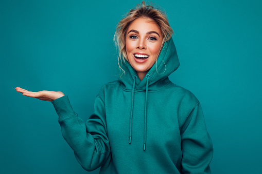Close-up photo of trendy cheerful woman wearing hoodie