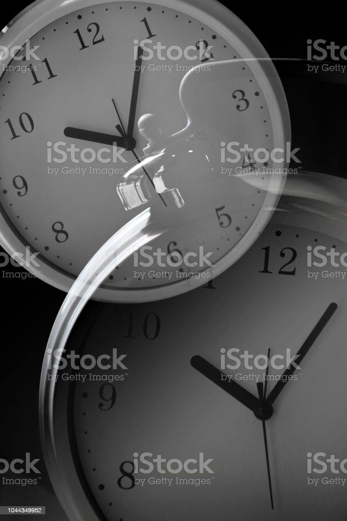 Tilt double exposure photo of two clock faces
