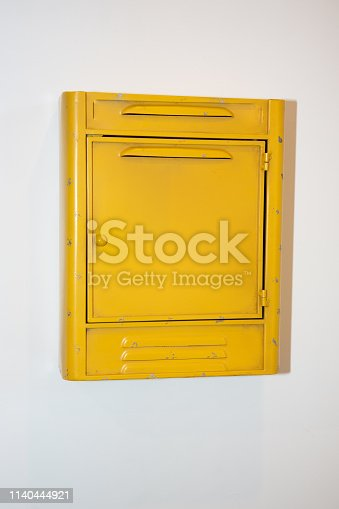 istock Close-up photo of vintage yellow mail box 1140444921