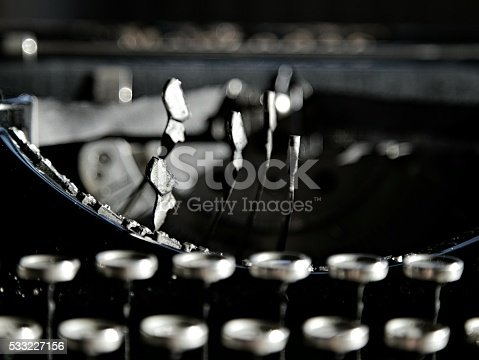 504606248 istock photo Closeup photo on black vintage typewriter. 533227156