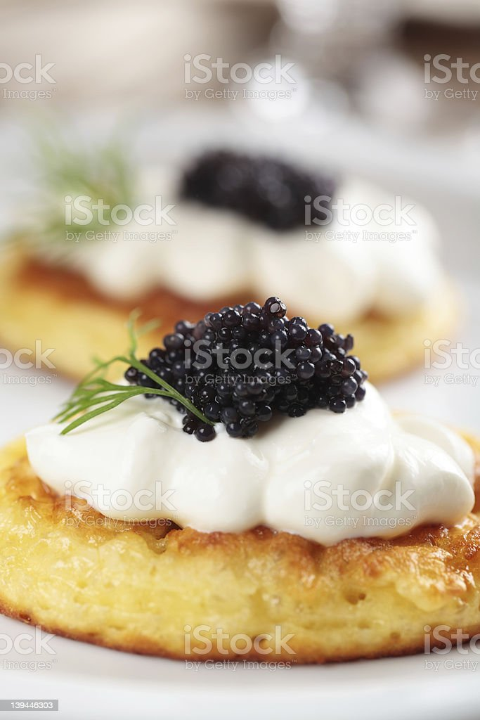 Close-up photograph of blinis topped with caviar stock photo