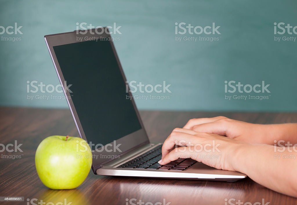 Close-up photograph of hands using a laptop stock photo