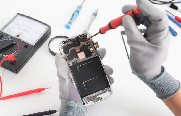 Close-up photos showing process of mobile phone repair stock photo