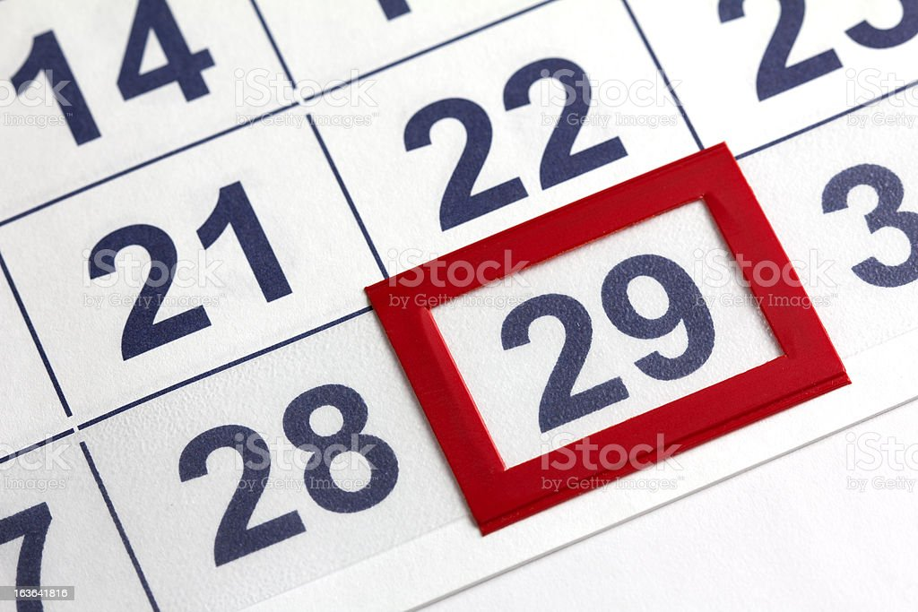 Close-up picture of a calendar with 29 enclosed in red stock photo