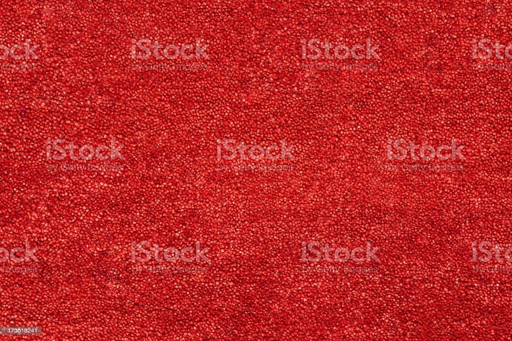 A closeup picture of a clean and bright red carpet stock photo