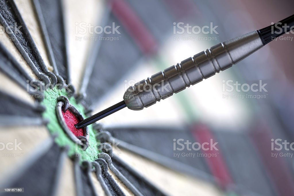 Closeup picture of a dart in the Bulls-eye royalty-free stock photo