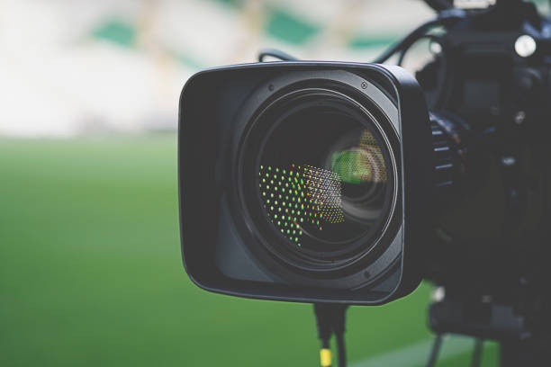 Close-up picture of a professional tv camera before broadcasting. Movie, Movie Theater, Home Video Camera, Lens - Optical Instrument, Studio - Workplace performing arts event stock pictures, royalty-free photos & images