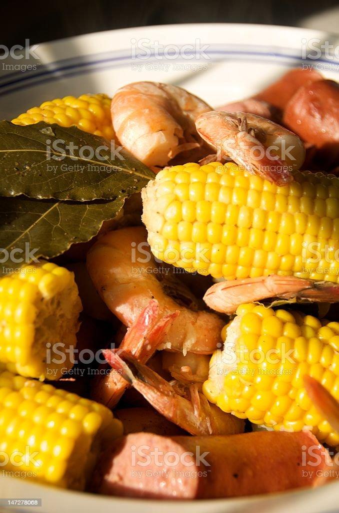 Close-up picture of a shrimp boil shrimp, corn, sausage stock photo