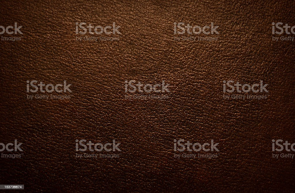 Closeup picture of a textured brown leather fabric stock photo