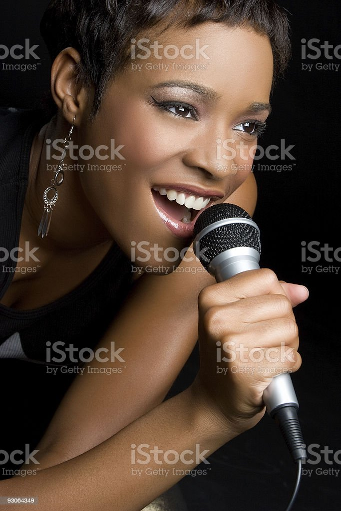 Close-up picture of a woman singing in to a microphone stock photo
