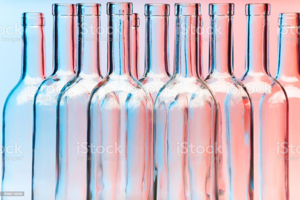 Close-up picture of clear glass wine bottles stock photo