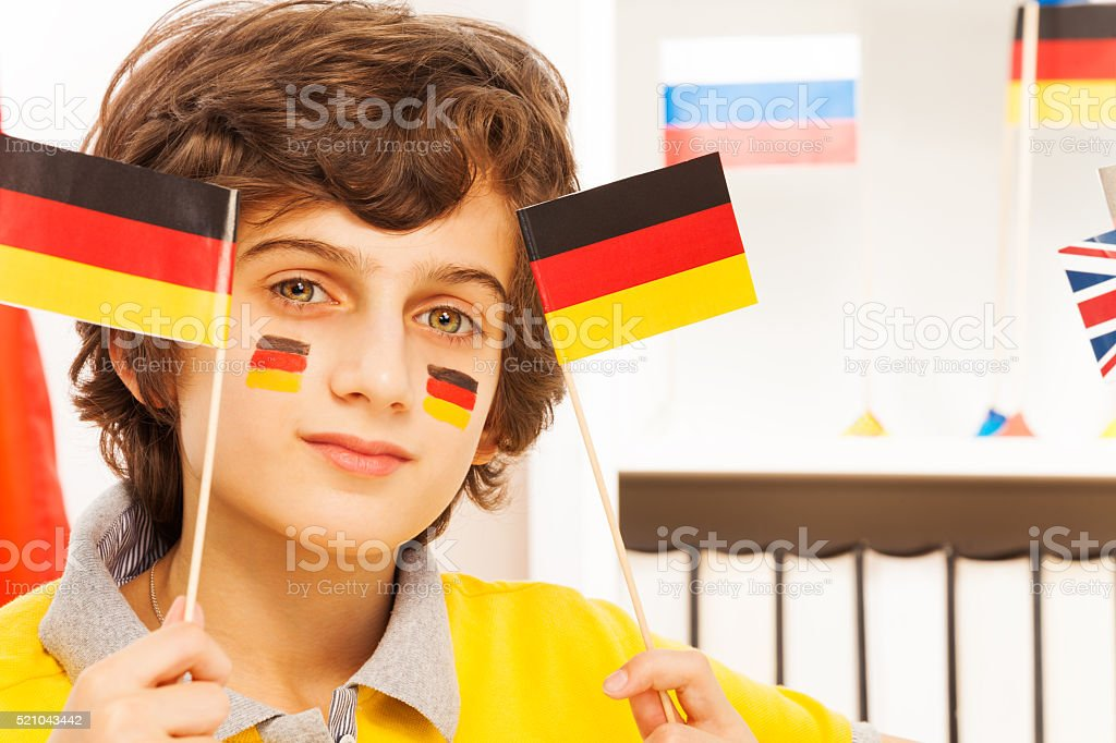 Close-up picture of German boy with flags stock photo