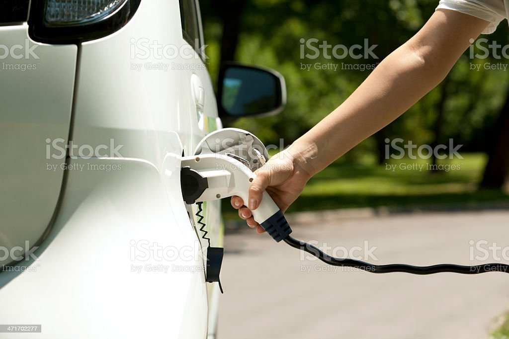 Closeup picture of how to insert charge in electric car  stock photo
