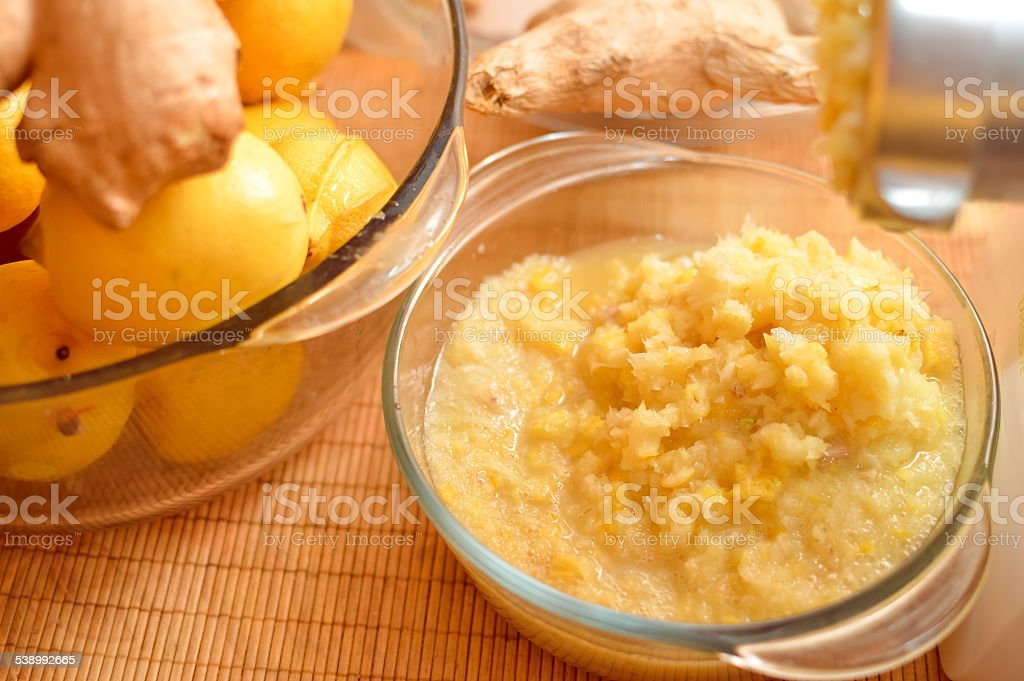 closeup picture of lemon & ginger in glass bowls. stock photo