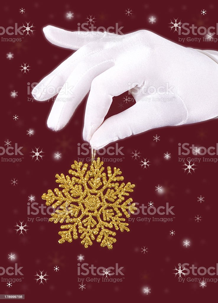 closeup picture of woman's hands holding a snowflake royalty-free stock photo
