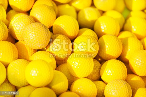 istock Close-up picture of yellow golf balls pile 671992622