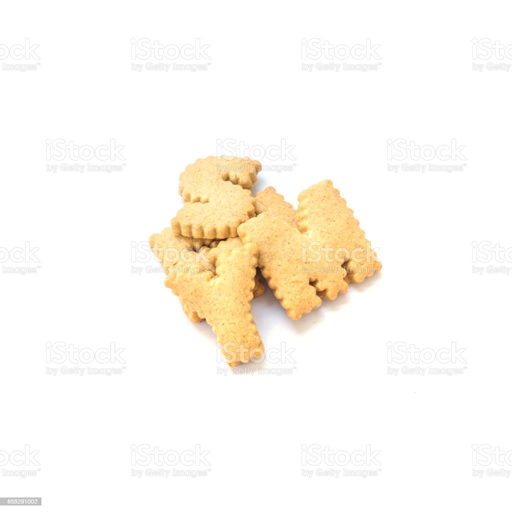 Closeup pile of brown biscuit in english alphabet isolated on white background stock photo