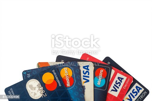 Sarajevo, Bosnia and Herzegovina - Jun 25, 2017: closeup pile of credit cards, Visa and MasterCard, credit, debit and electronic. Isolated on white background with clipping path. Design element.