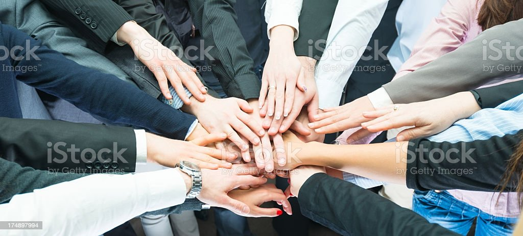 Closeup pile of hands , business partners royalty-free stock photo