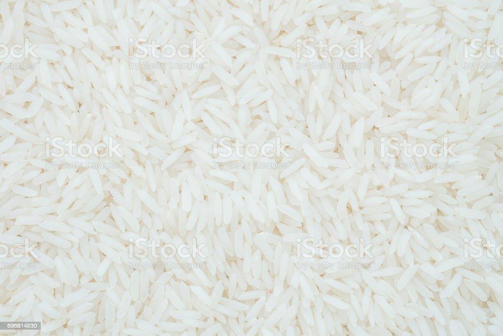 Closeup pile of white rice called jasmine rice textured background stock photo