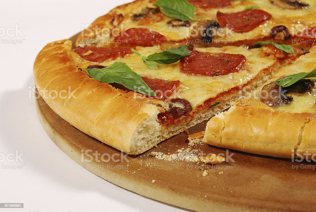 Closeup pizza with crumbs royalty-free stock photo
