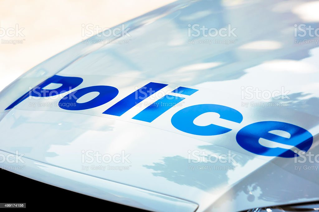 Closeup police car bonnet with sign police, copy space stock photo