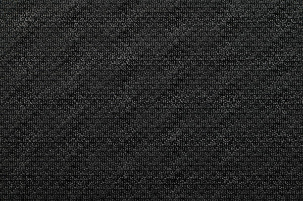 Close-up polyester fabric texture of black athletic shirt stock photo