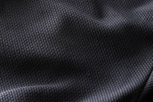 close-up polyester fabric texture of black athletic shirt - nylon texture stock pictures, royalty-free photos & images