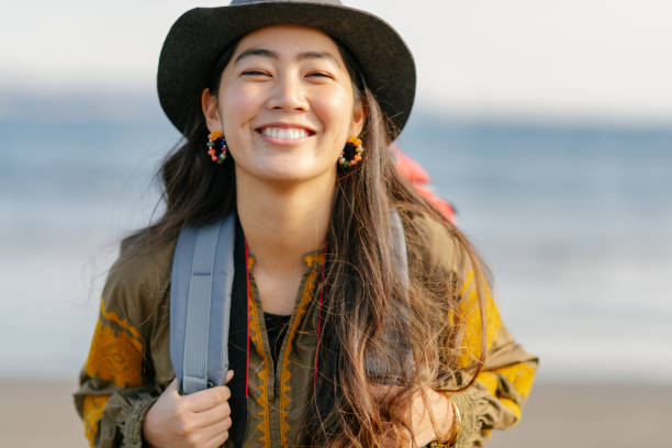 Close-up portait of happy female solo traveller stock photo