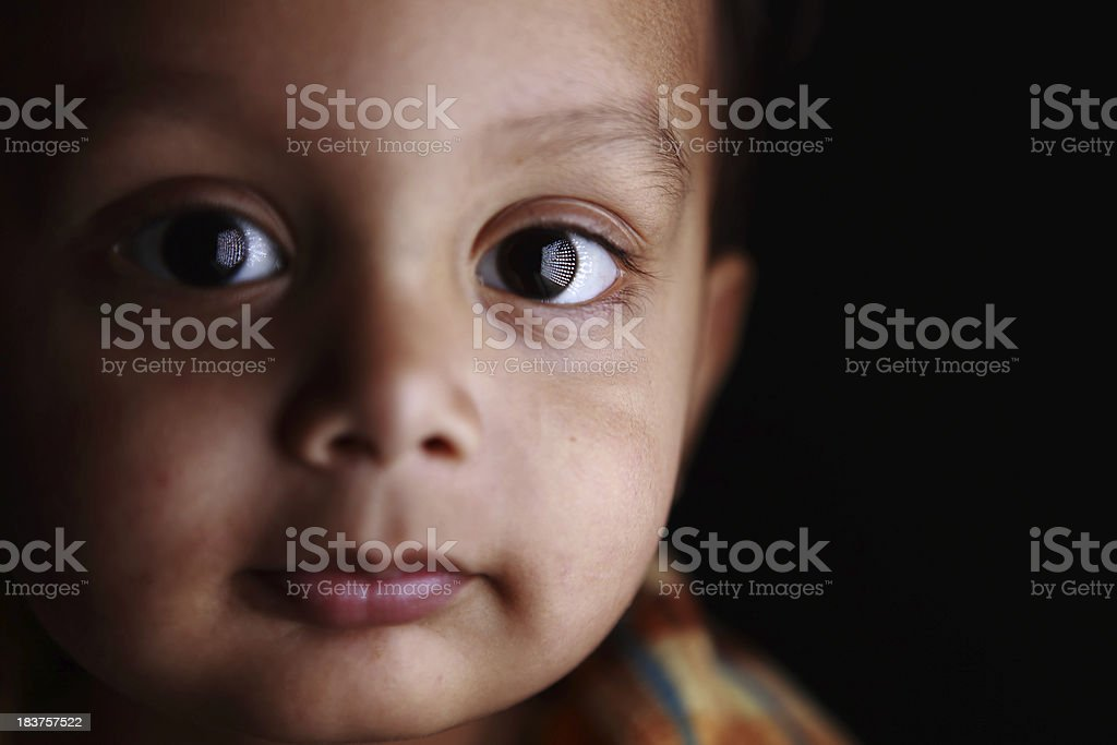 Closeup Portrait 2 year old Indian Boy with interesting catch-light stock photo