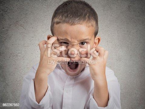 istock Closeup portrait angry child 662267552