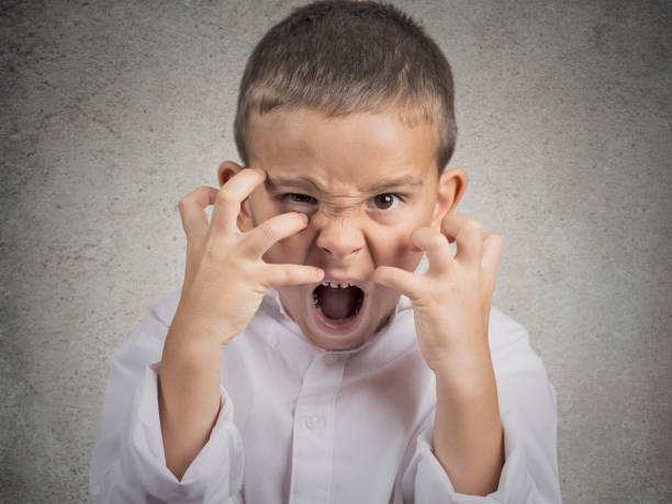 closeup portrait angry child - aggression stock pictures, royalty-free photos & images