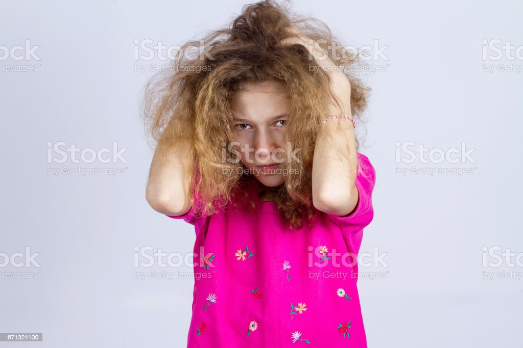 Closeup portrait angry, sad upset, grumpy, stressed little young girl, stock photo